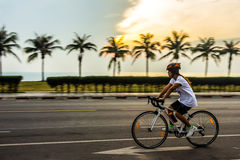 Cycling the early morning hours Stock Images