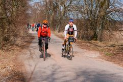 Cycling in early spring, cyclists outside the city stock photos