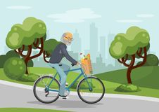 Cycling elderly man in the city Royalty Free Stock Photos