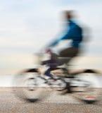 Cycling on embankment Stock Photos