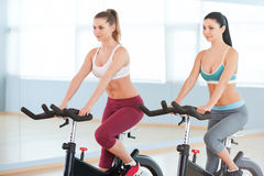 Cycling on exercise bikes. Stock Images