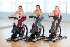 Cycling on exercise bikes. Royalty Free Stock Photography
