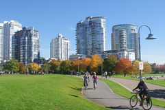 Cycling in the fall. Along sea wall in Vancouver, Canada royalty free stock photos