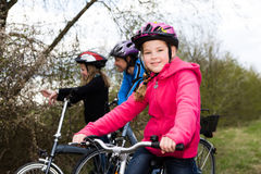 Cycling family. A cycling family in front of rural landscape Stock Images