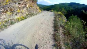 Cycling fast on extreme terrain stock video footage