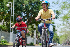 Cycling father and kid Stock Images