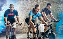 Cycling fitness class. Active people on cycling fitness class Royalty Free Stock Photos
