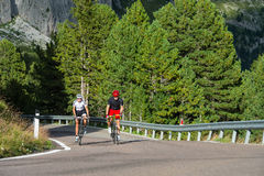 Cycling in the forest-good air to breathe. A couple make a trip in the forest Stock Photo