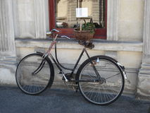 Cycling in France. Unattended bicycle in quiet French village of Corne in the Loire Valley Stock Photography