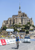 Cycling in Front of Le Mont Saint Michel. Le Mont Saint Michel,France- July 10,2013: The Australian cyclist Matthew Harley Goss from  Orica-GreenEDGE Team Royalty Free Stock Photos