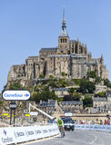 Cycling in Front of Le Mont Saint Michel Royalty Free Stock Image