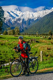 Cycling in front of Mount Cook Royalty Free Stock Images