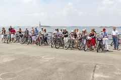 Cycling fun on Governors Island with the Statue of Liberty in the background, New York, United States stock images