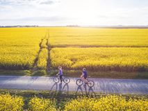 Cycling, group of young people with bicycles royalty free stock photography