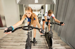 Cycling gym beautiful woman man Royalty Free Stock Images