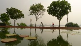 Cycling in Hazy Singapore Stock Photo
