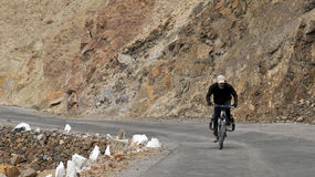 Cycling  in the Himalayas Stock Photo