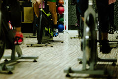 Cycling indoors workout. Interval Cycling for weightloss Royalty Free Stock Photography