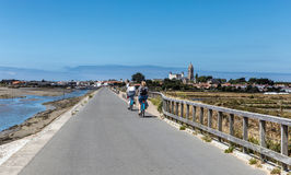 Cycling on the Jetty Jacobsen. Two women cycling on the Jacobsen Jetty on the island of Noirmoutier & x28;France& x29 Stock Images
