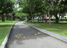 Cycling and Jogging Path. Singapore - July 2016  A cycling and jogging path that winds through the Punggol Park in Singapore, with  painted yellow outline of a Royalty Free Stock Images
