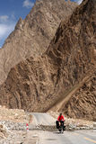 Cycling Through Karakorum. Cycling through remote mountain road in Karakorum Royalty Free Stock Photography