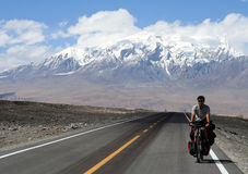 Cycling on Karakorum Highway Royalty Free Stock Photo