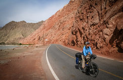Cycling Karakorum Highway. Single female cyclist on the bicycle cycling on the Karakorum Highway in China royalty free stock images