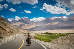 Cycling on Karakorum Highway Royalty Free Stock Images