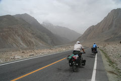 Cycling on Karakorum Highway Royalty Free Stock Image