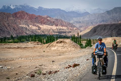 Cycling on Karakorum Highway Royalty Free Stock Photos