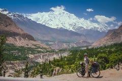 Cycling on Karakorum Highway Royalty Free Stock Image