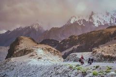 Cycling on Karakorum Highway Royalty Free Stock Photography