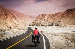 Cycling on Karakorum Highway Stock Photo