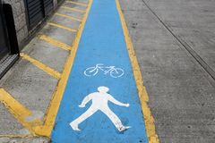UK cycling lane. Cycling lane in the city - London, UK. Bike route Royalty Free Stock Images