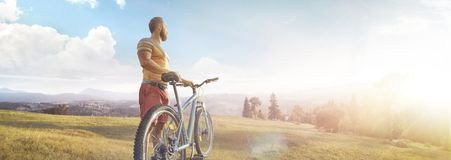 Free Cycling. Man With Bike On A Forest Road In The Mountains On A Summer Day. Mountain Valley During Sunrise. Panorama Royalty Free Stock Photos - 163783608