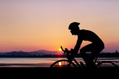 Cycling at mountain beach on twilight Stock Images