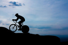 Cycling on mountain hill Royalty Free Stock Images
