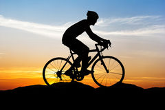 Cycling on mountain sunset time Royalty Free Stock Image