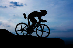 Cycling on the mountain Stock Images
