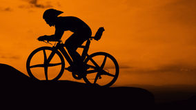 Cycling on the mountain Royalty Free Stock Photos