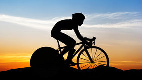 Cycling at mountain on twilight Royalty Free Stock Photography