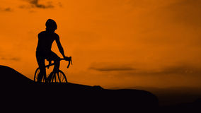 Cycling on mountain Stock Images