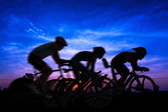 Cycling at mountain on twilight Royalty Free Stock Photos