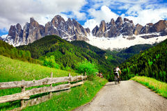 Cycling in mountains, Dolomites. North Italy Royalty Free Stock Image