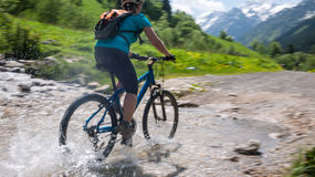 Cycling in mountains Stock Photo