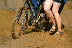 Cycling in mud royalty free stock photography