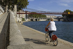 Cycling near the saone river in Lyon Stock Images