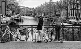 Amsterdam bicycle, dutch icon, in an outdoor enviroument with kid. Cycling is one of the best ways to get around Amsterdam, and no visitor should leave without stock images