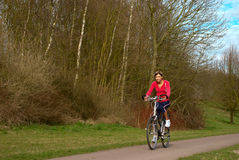 Cycling in a Park Stock Photo