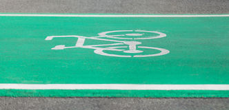Cycling Path Green Lane with the Bikeway Symbol. In Bangkok Public Park Stock Photo